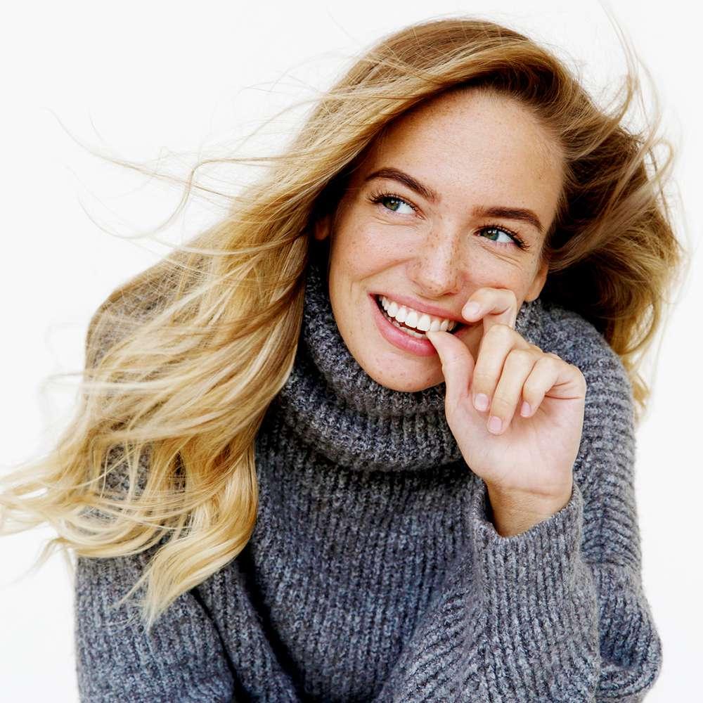 person smiling in studio portrait