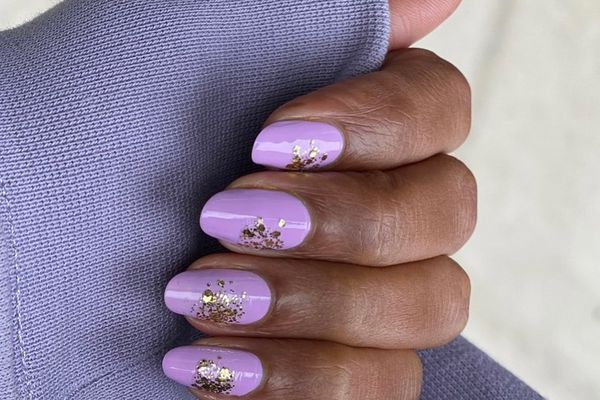 Person with pastel purple nails.