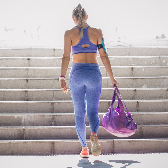 Best gym bag: Woman carrying a gym bag