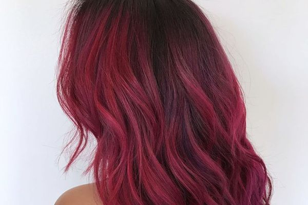 Woman with magenta ombre hair