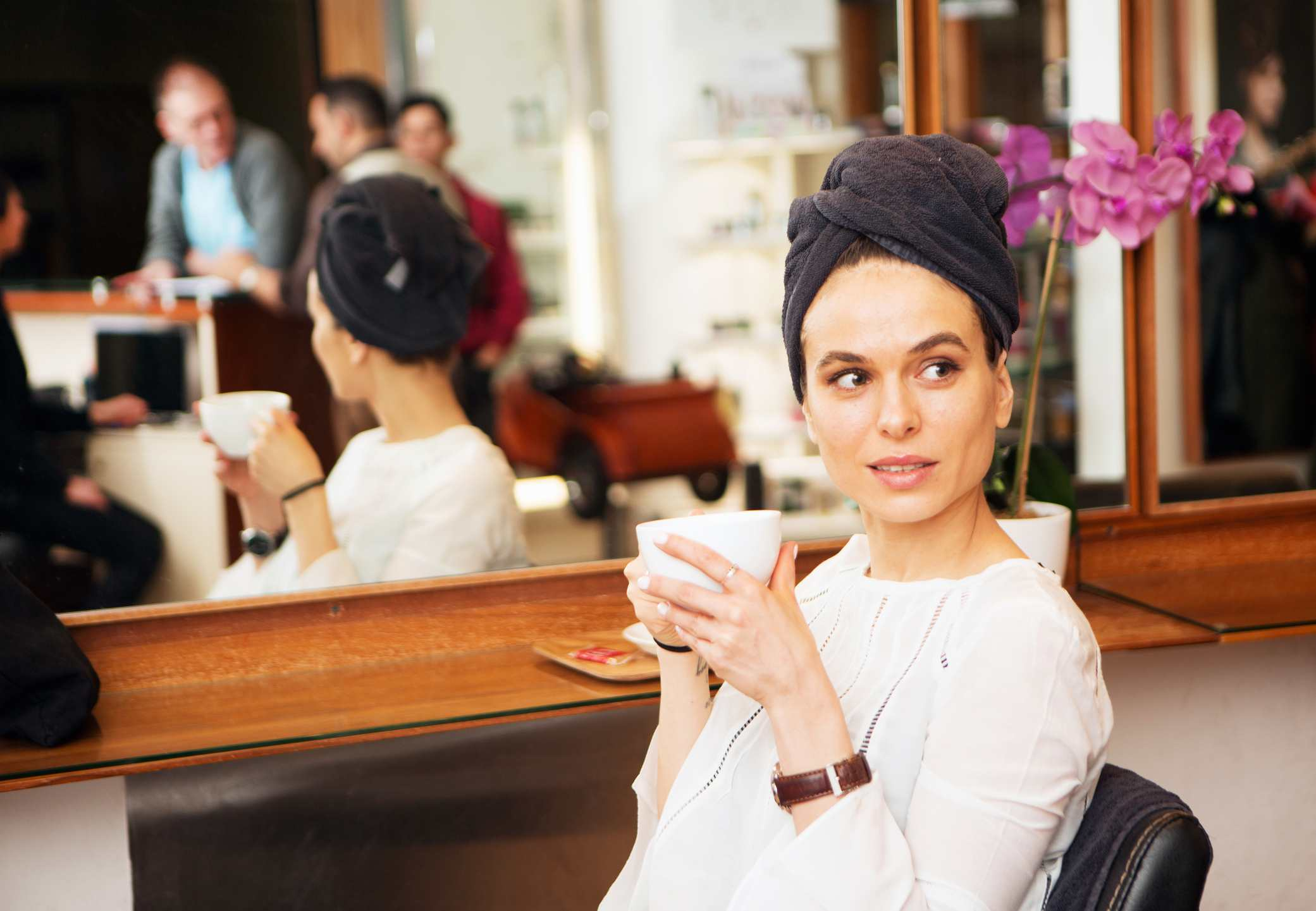 Female salon customer with a coffee cup