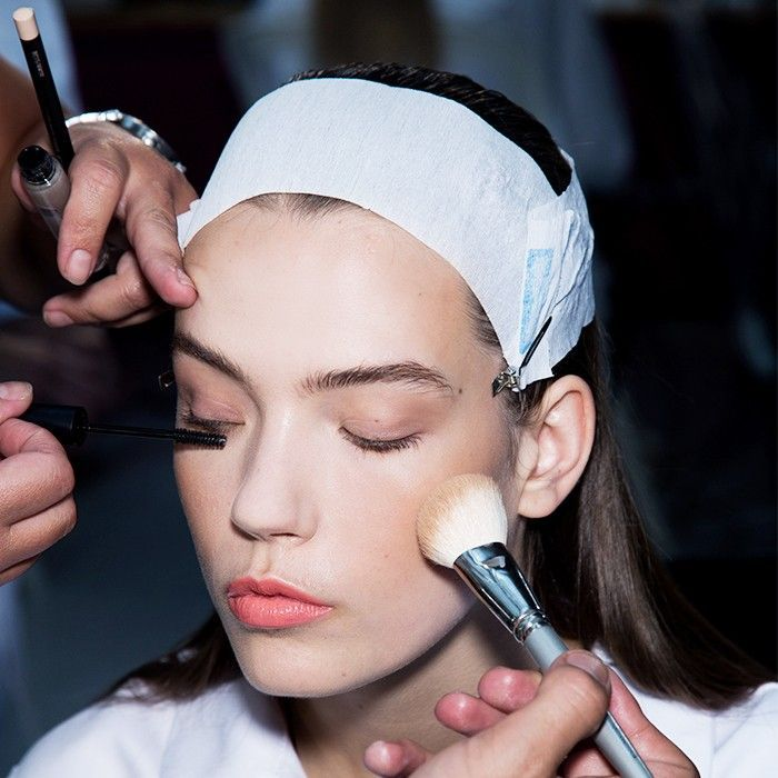 Best drugstore makeup: woman having makeup applied to her face