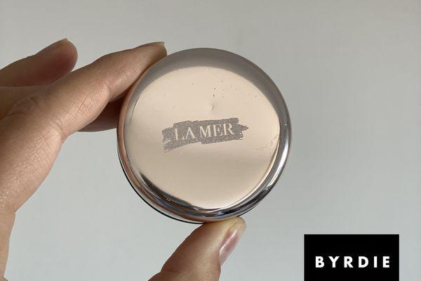 La Mer's Lip Balm, held by the author