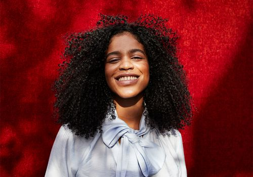 patchy sun portrait of girl with natural hair