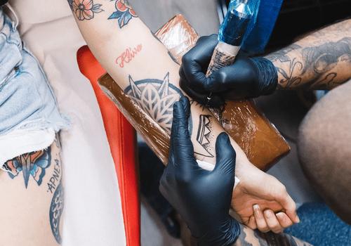 Women getting tattooed