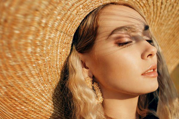person wearing sun hat