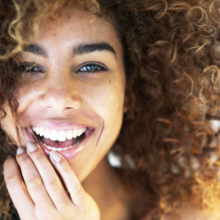 how to improve your smile: Woman with white, straight teeth