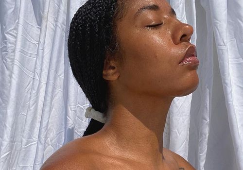 woman with glowy skin and closed eyes