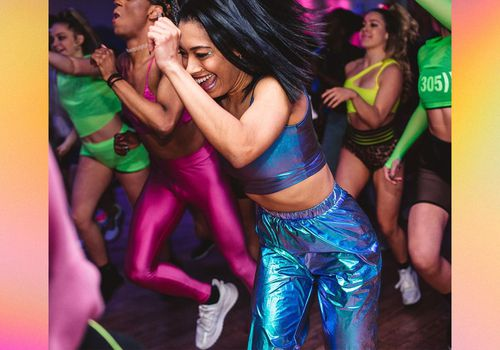 People in vibrant clothes enjoy a fitness class