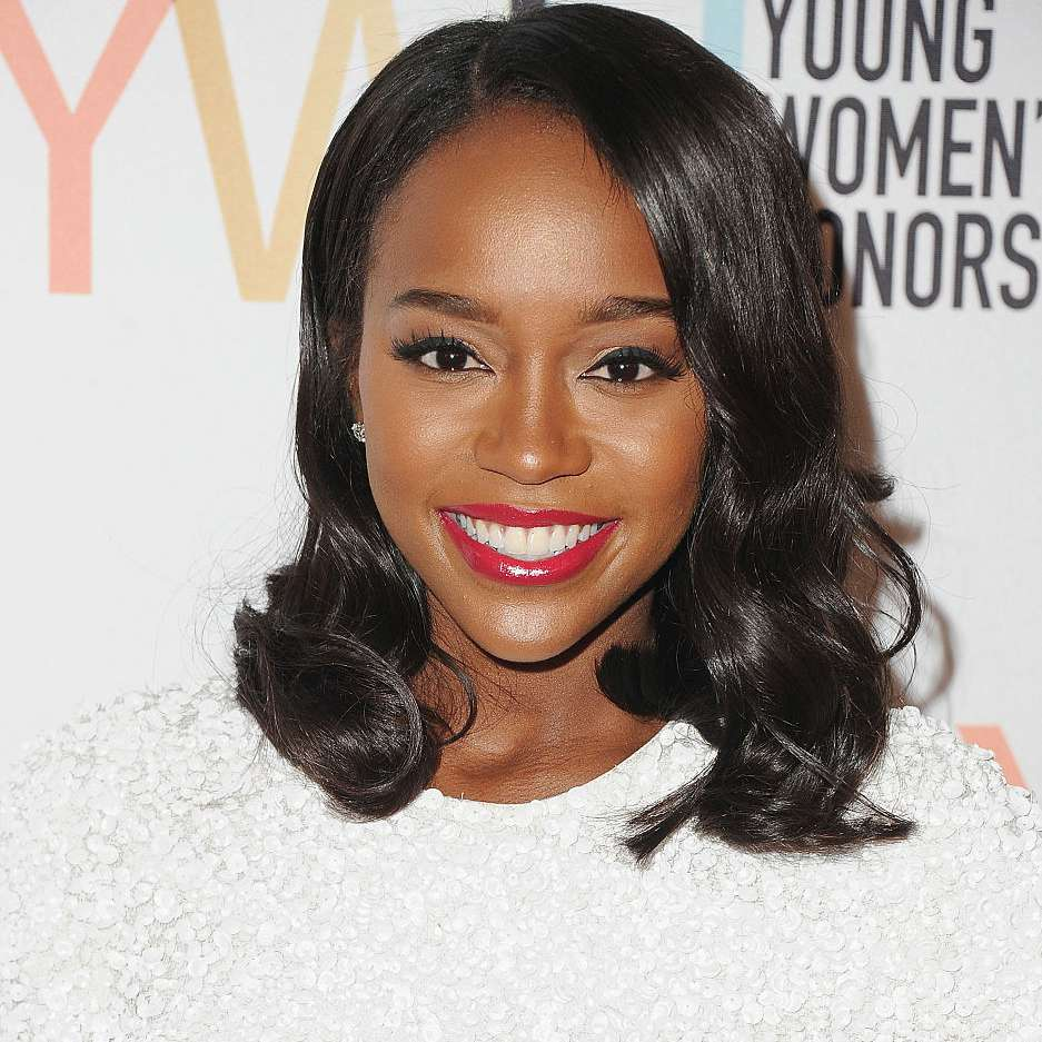 Aja Naomi King glossy wavy shoulder-length hair