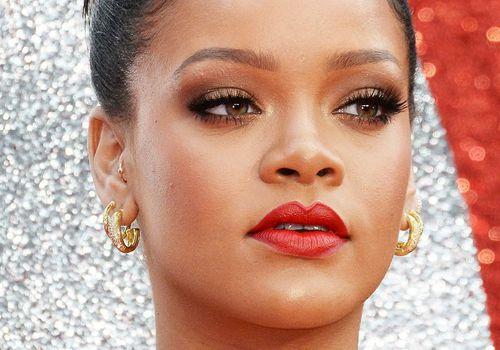 pop star rihanna with smokey eye and red lipstick
