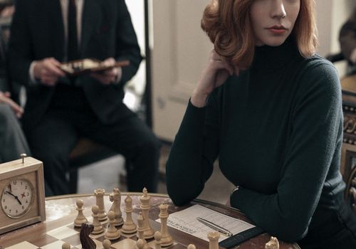 Queen's Gambit at chess table