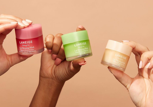 three hands holding up different laneige lip sleeping masks