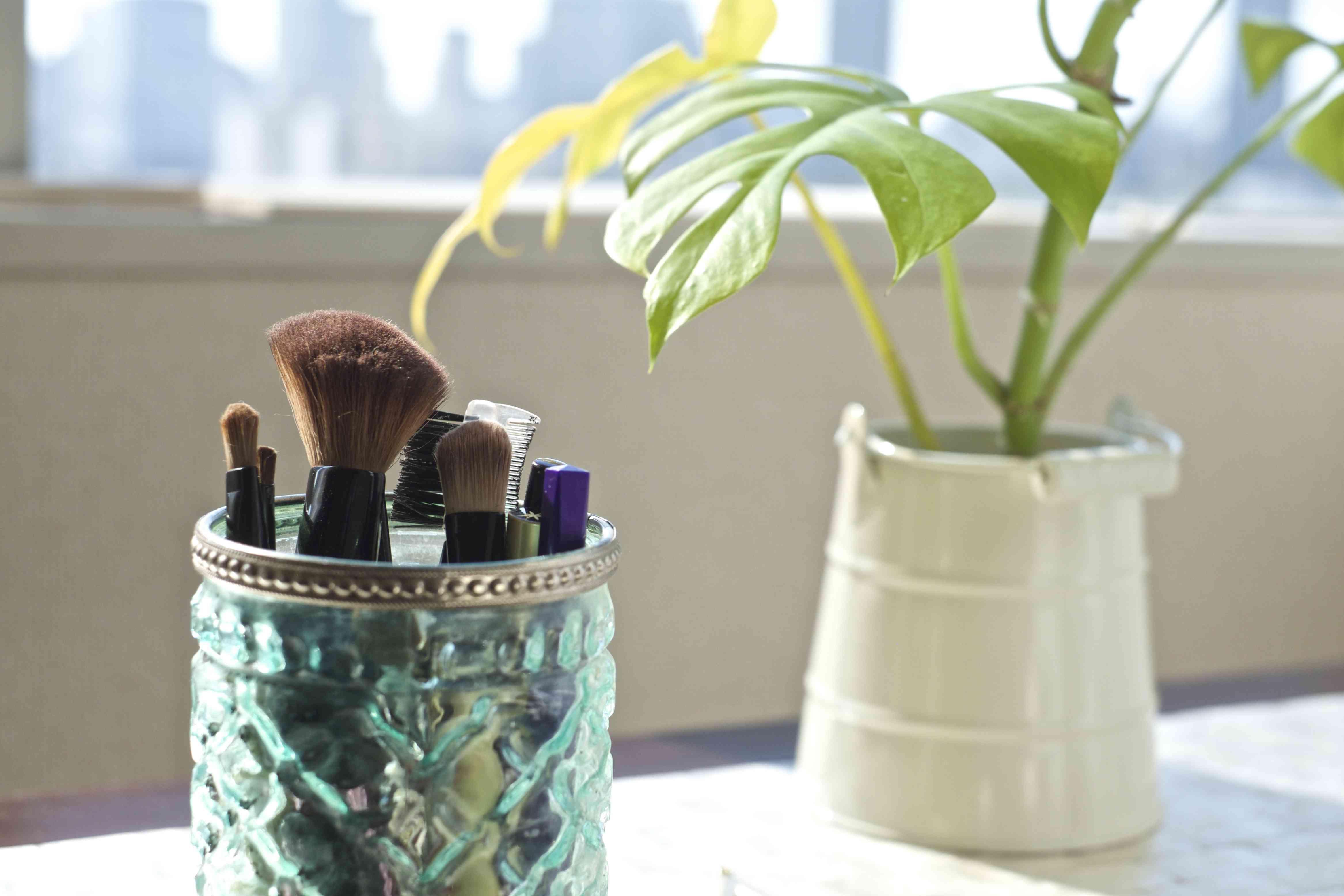 Makeup brushes in jar