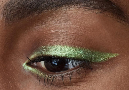 woman wearing shimmery green eyeshadow