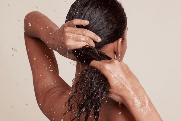 woman wringing moisture out from hair