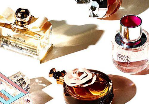 Various perfumes on white background