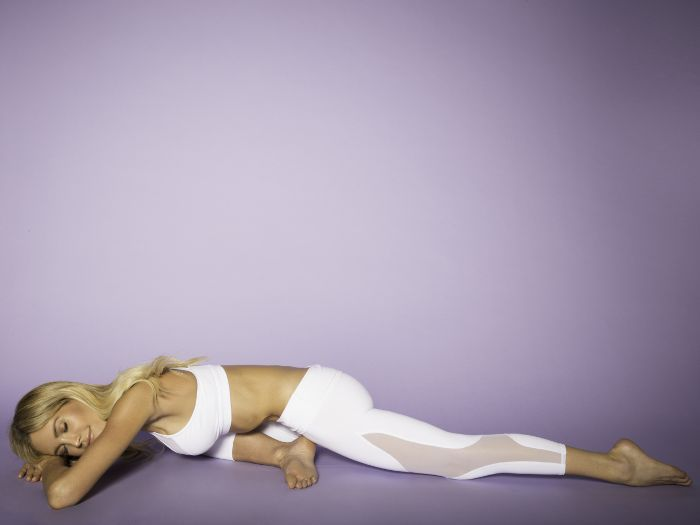 Woman in pigeon pose