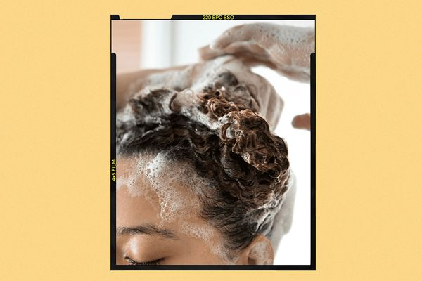 Woman lathering shampoo in her haire