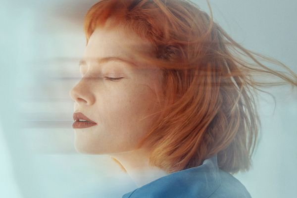 Red-haired woman with bangs in motion