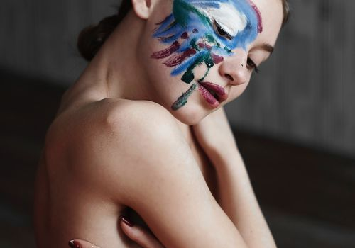 woman with artsy face paint/makeup