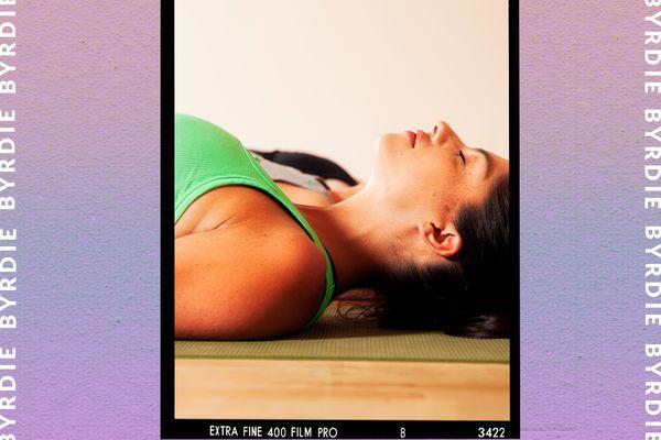 woman laying on yoga mat