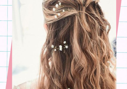 woman with long wedding hairstyle and flowers