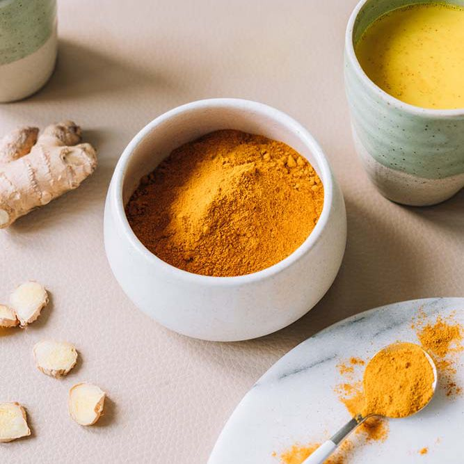 powdered turmeric and marble porcelain plateware