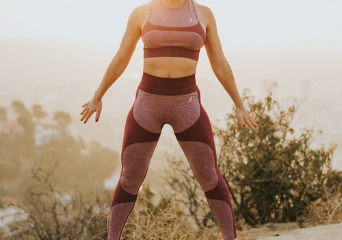 Woman jumping on hiking trail