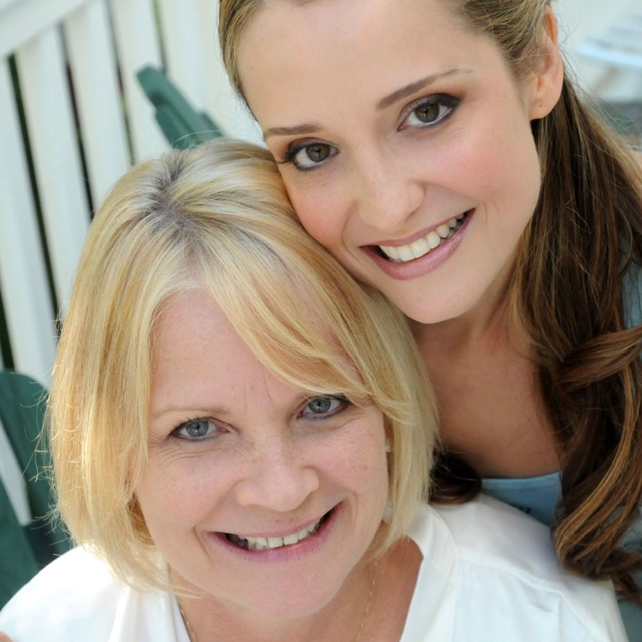 A picture of a mother and daughter smiling