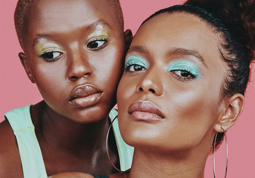 two femmes with colorful makeup