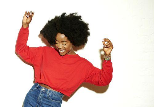 Happy black woman in a red sweatshirt