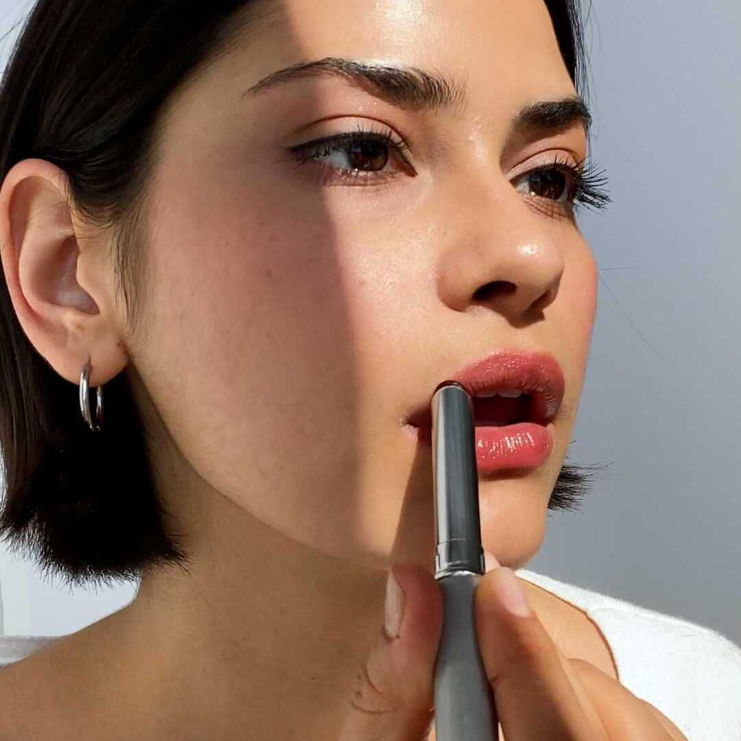 Woman wearing clinique black honey lipstick