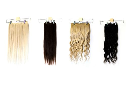 Various kinds of hair extensions, blonde and brown, straight and wavy
