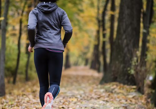 Woman running trail jogging