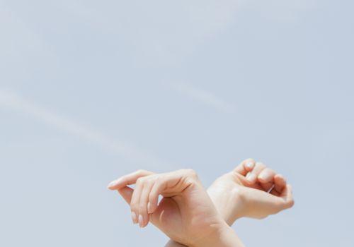 Woman's wrist against a blue sky