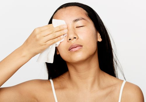 woman with makeup wipe
