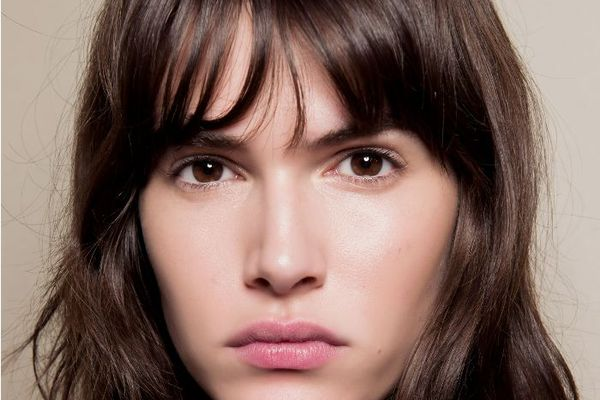 woman with clear skin, brown hair; best botox alternatives