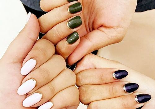 three hands with manicures