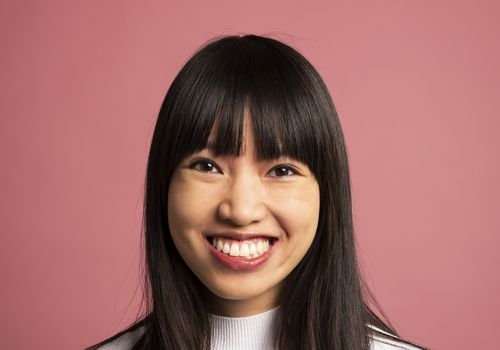 asian american woman on pink background