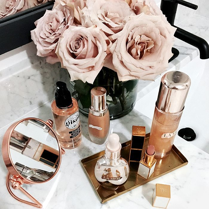 Beauty products spread out on bathroom vanity
