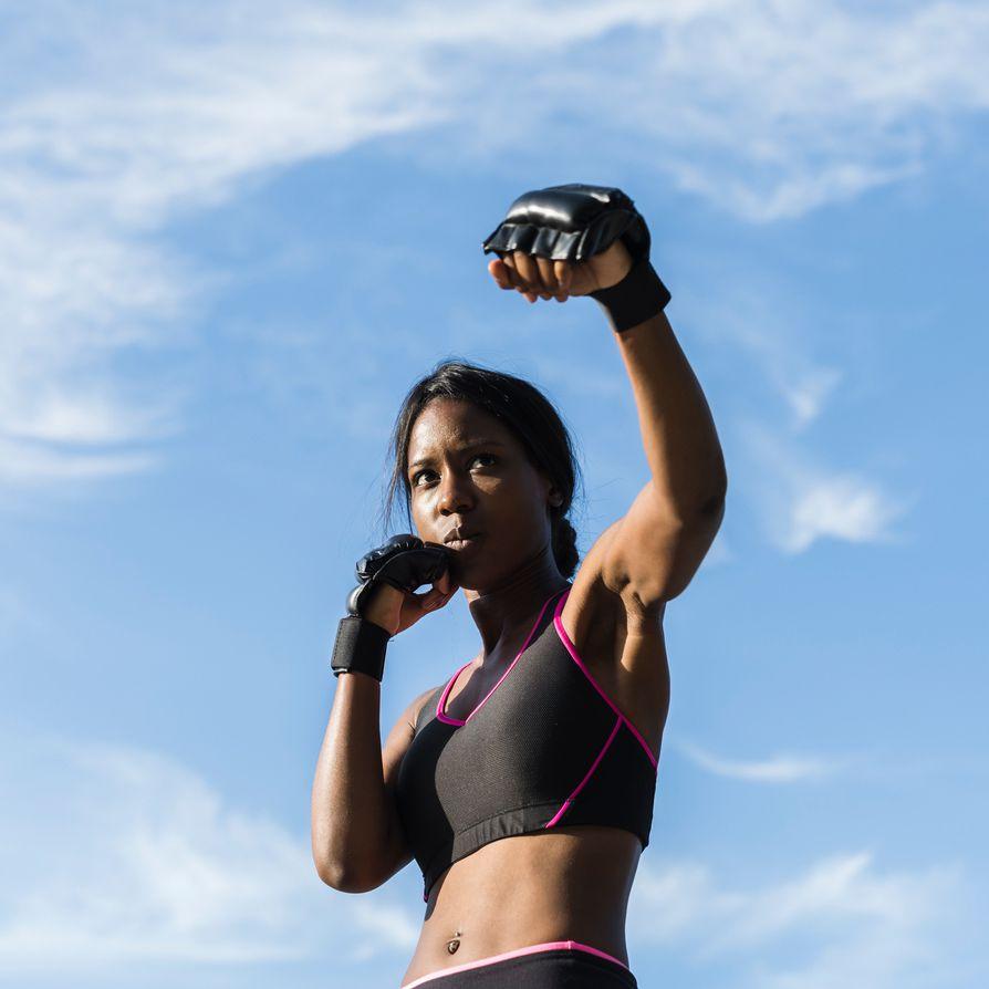 black femme boxing outside