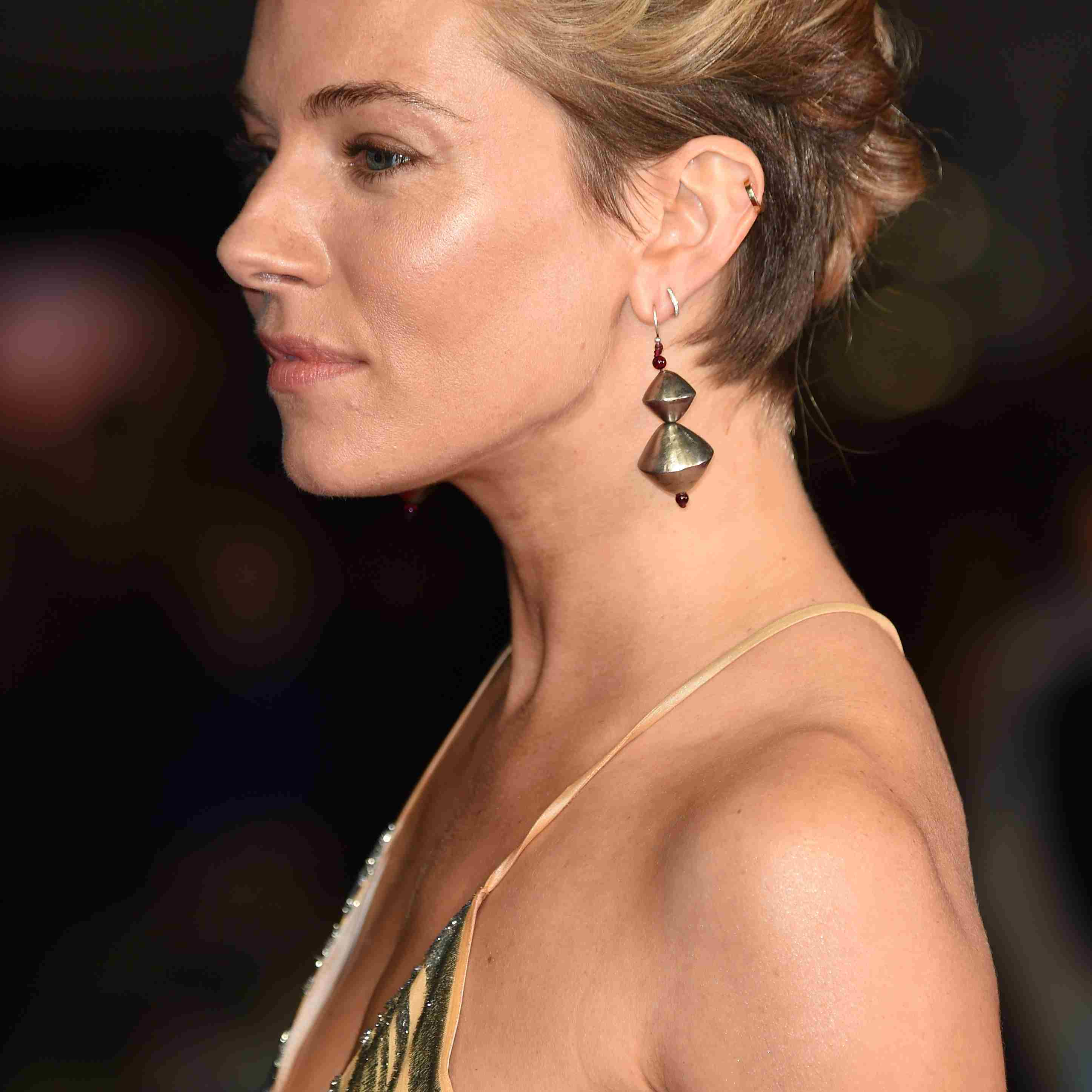 Sienna Miller with double French braids