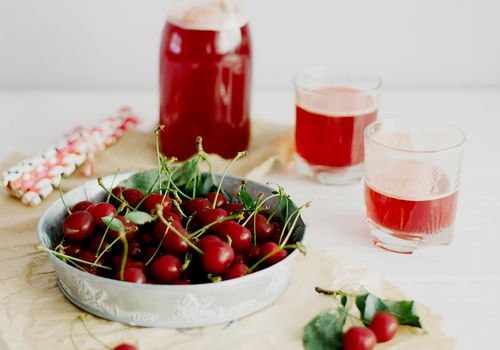 plate of cherries with cherry juice