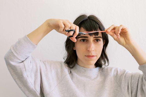 woman cutting bangs