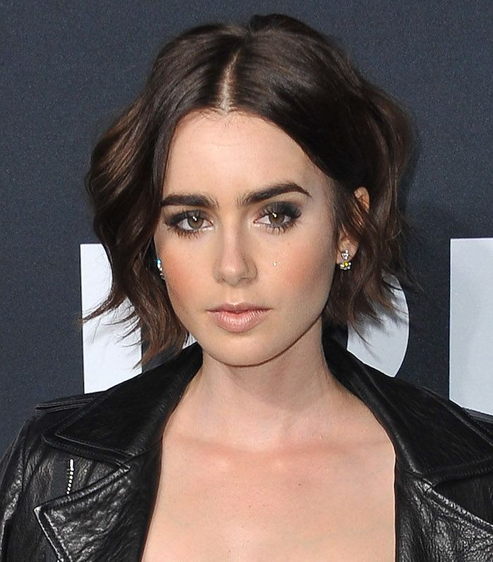 Lily Collins wavy bob with face-framing layers