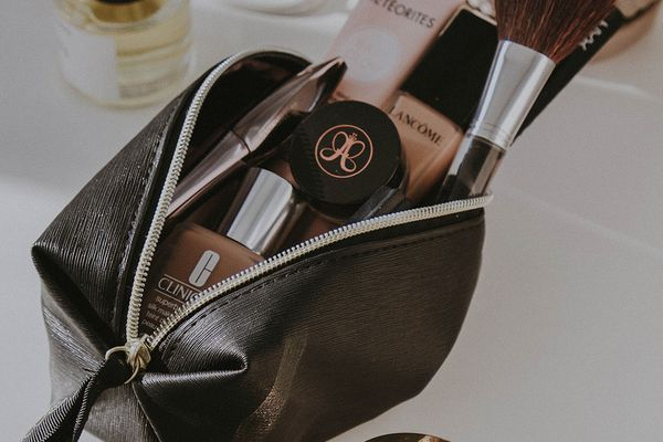 unzipped makeup bag and product
