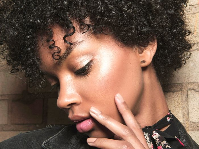 Black woman with short, curly hair