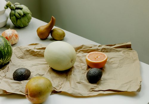 fruit and paper bag on table