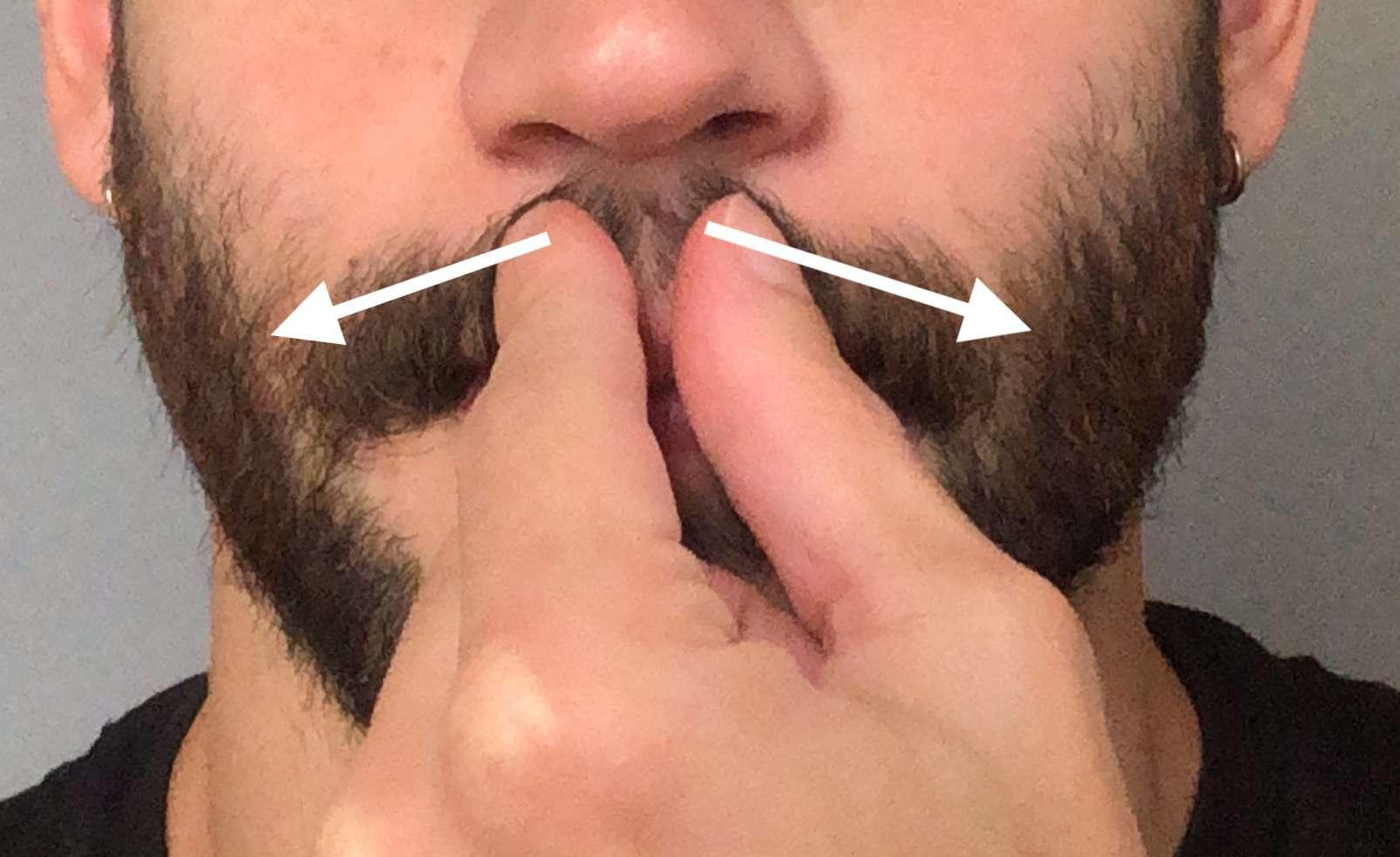 Apply mustache wax